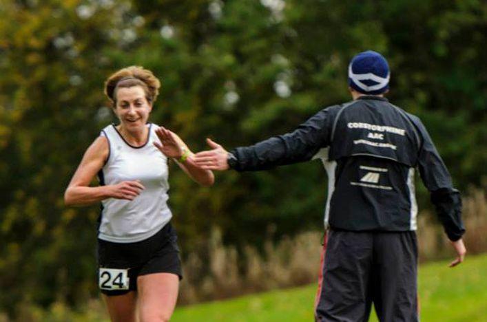 A coach directs a runner