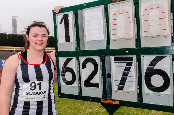 Rachel Hunter in front of results board
