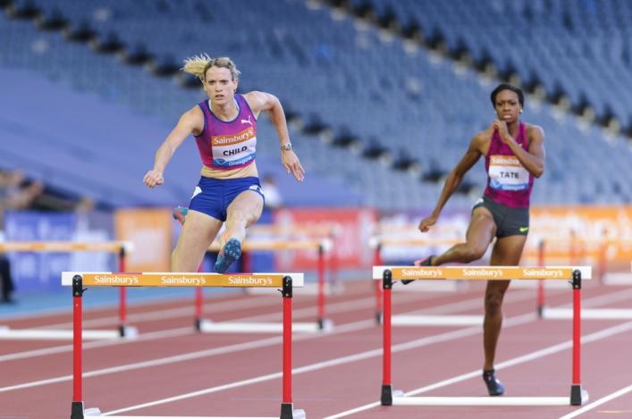 Eilidh Child clears a hurdle at the Glasgow Diamond League