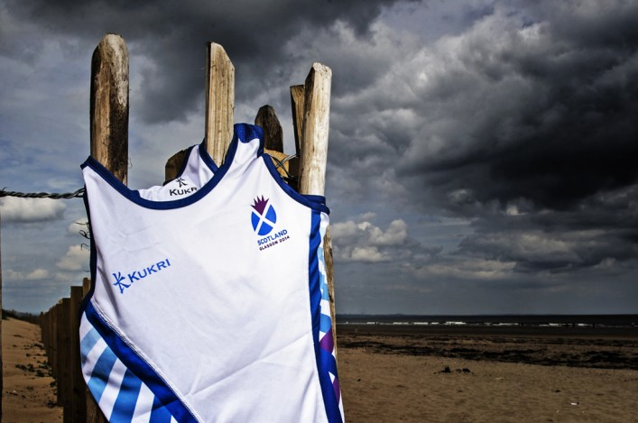 The white KUKRI Scotland vest for Glasgow 2014 flutters on St Andrews beach