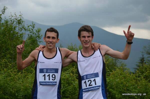 Andrew Douglas and Robbie Simpson celebrate hill running success in their Scotland vests