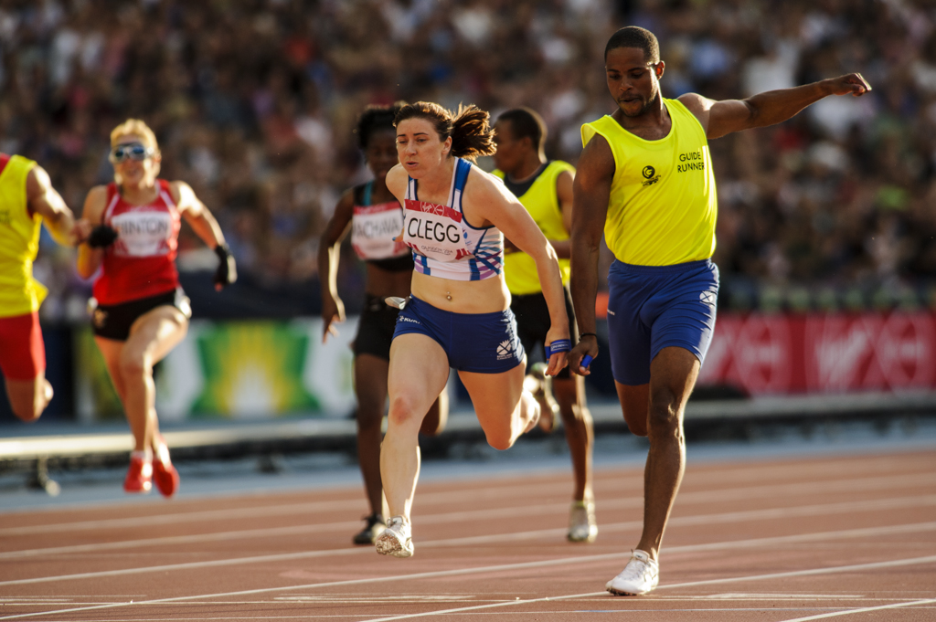Libby Clegg and guide runner mikail Huggins dip for the line to win gold at Commonwealth Games