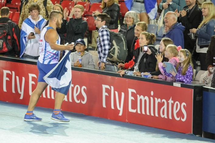 Mark Dry celebrates bronze medal