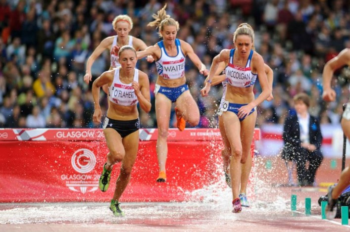 Lennie Waite and Eilish McColgan clear steeplechase barrier in Glasgow 2014 final at Hampden