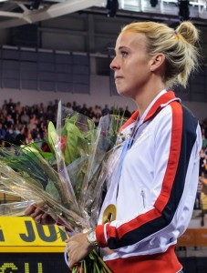 Lynsey Sharp clutches European Championship gold medal and flowers at Emirates Arena in January 2014
