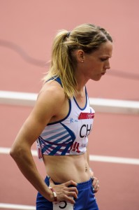 Eilidh Child with hands on hips at Hampden for Glasgow 2014 400m h heats