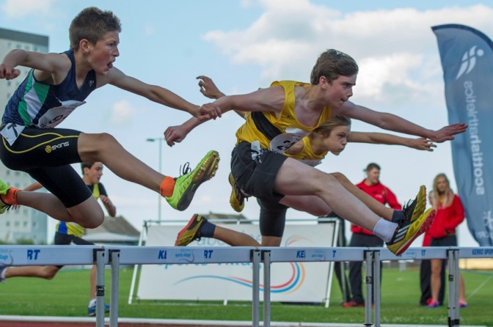 Hurdling action by young athletes at the Age Groups in Aberdeen in 2013