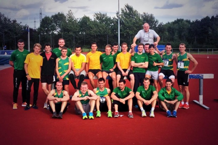 Glasgow athletes in yellow and green celebrate promotion