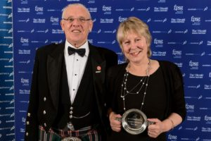Mairi Levack receivers her Honorary Life Membership award from Alan Potts